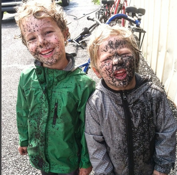 two muddy kids
